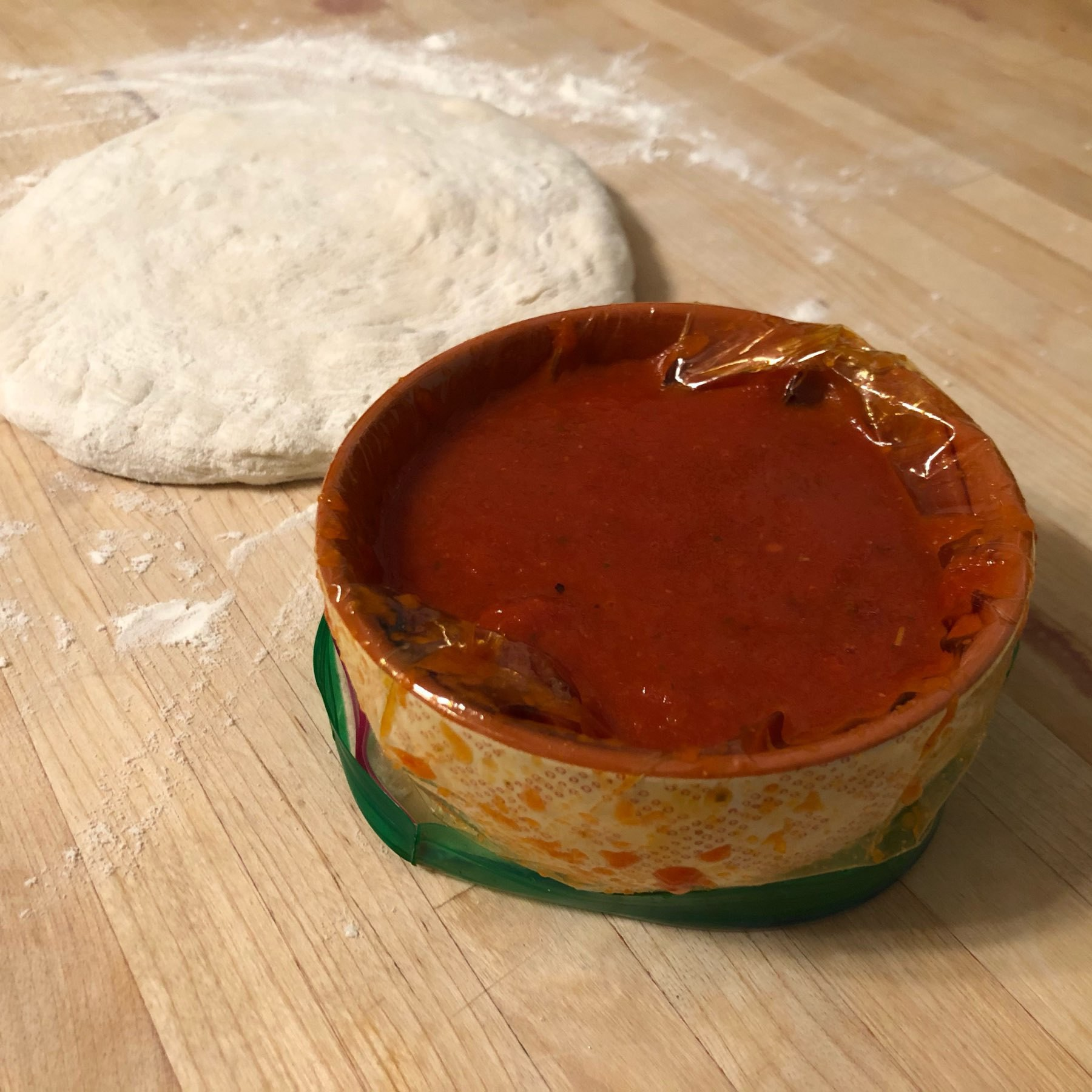 ceramic bowl with platic ziploc bag fit to hold thawed sauce