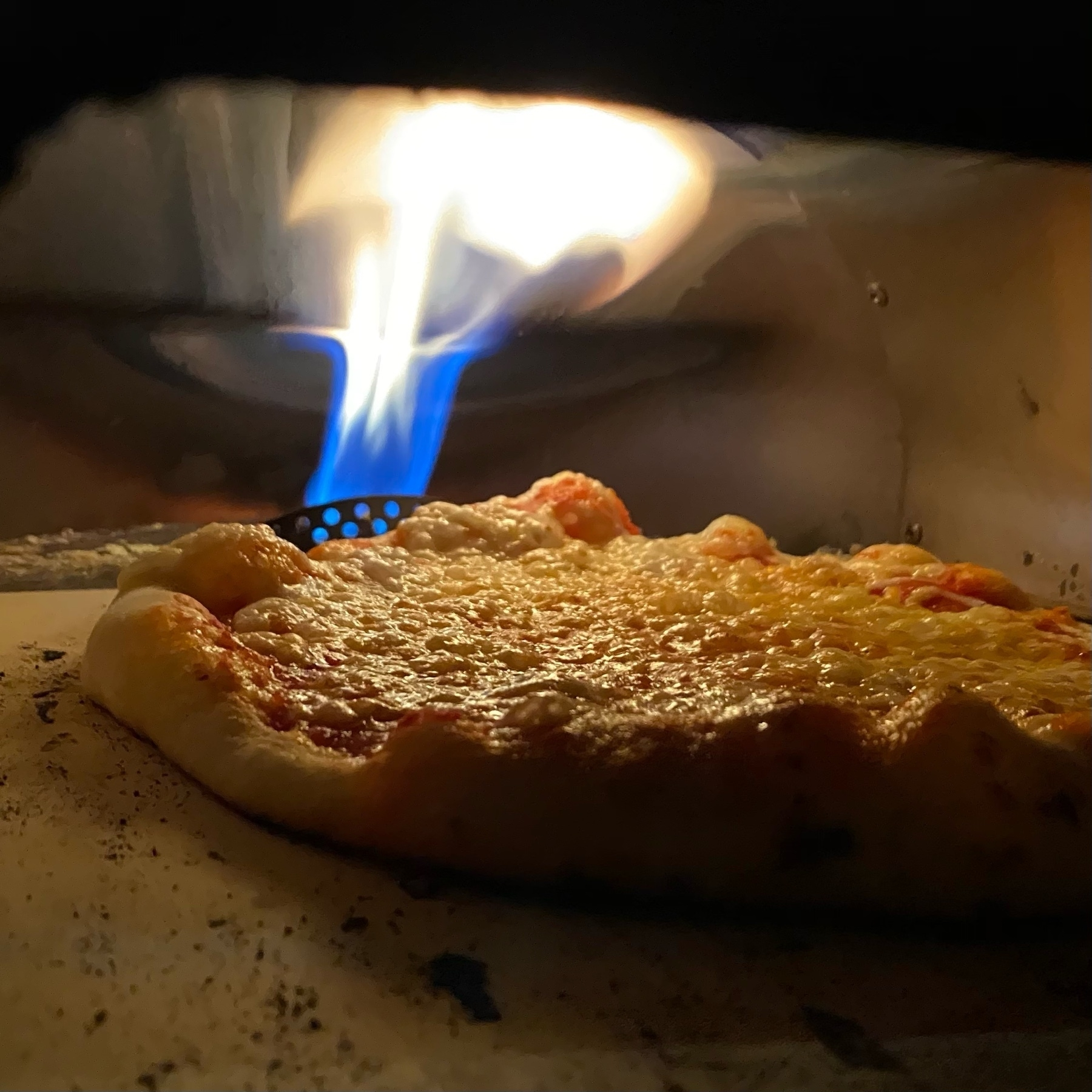 cheese pizza baking in an oven