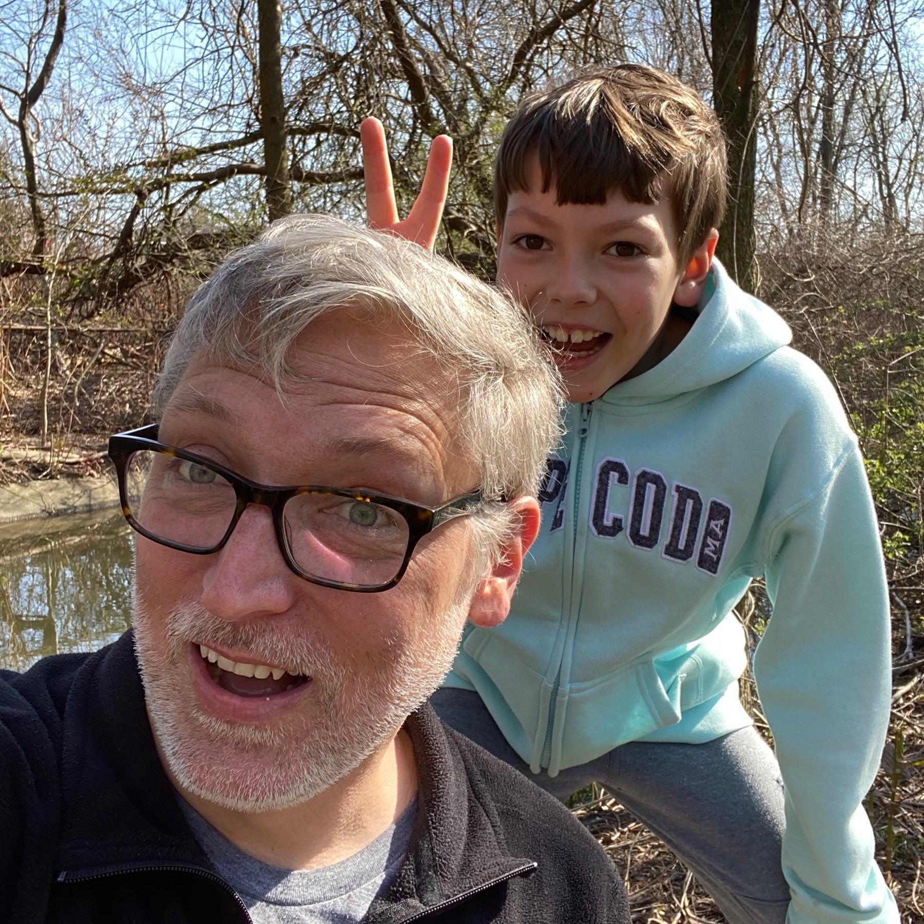 Self portrait with one boy giving me bunny ears