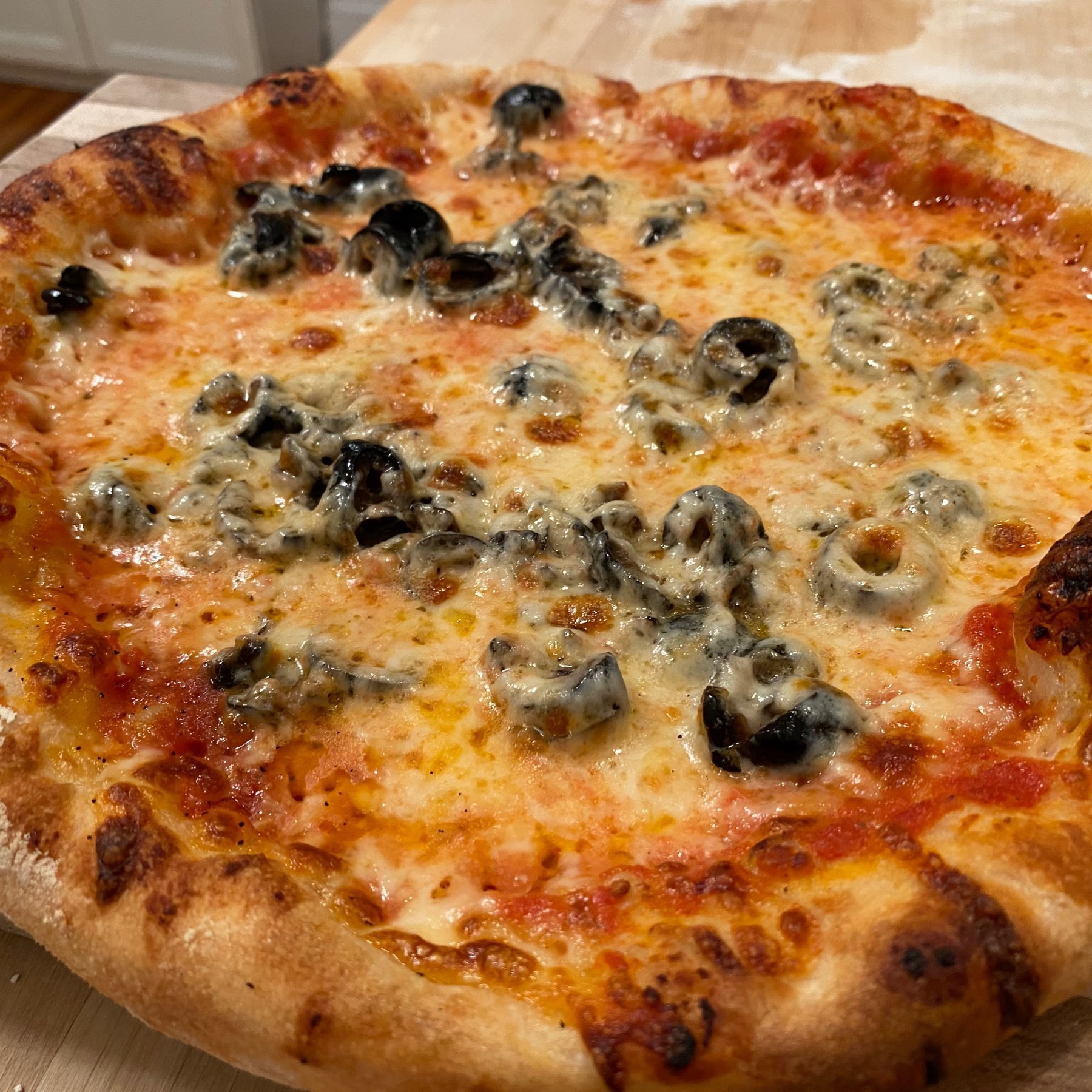 homemade olive pizza with puffy edges