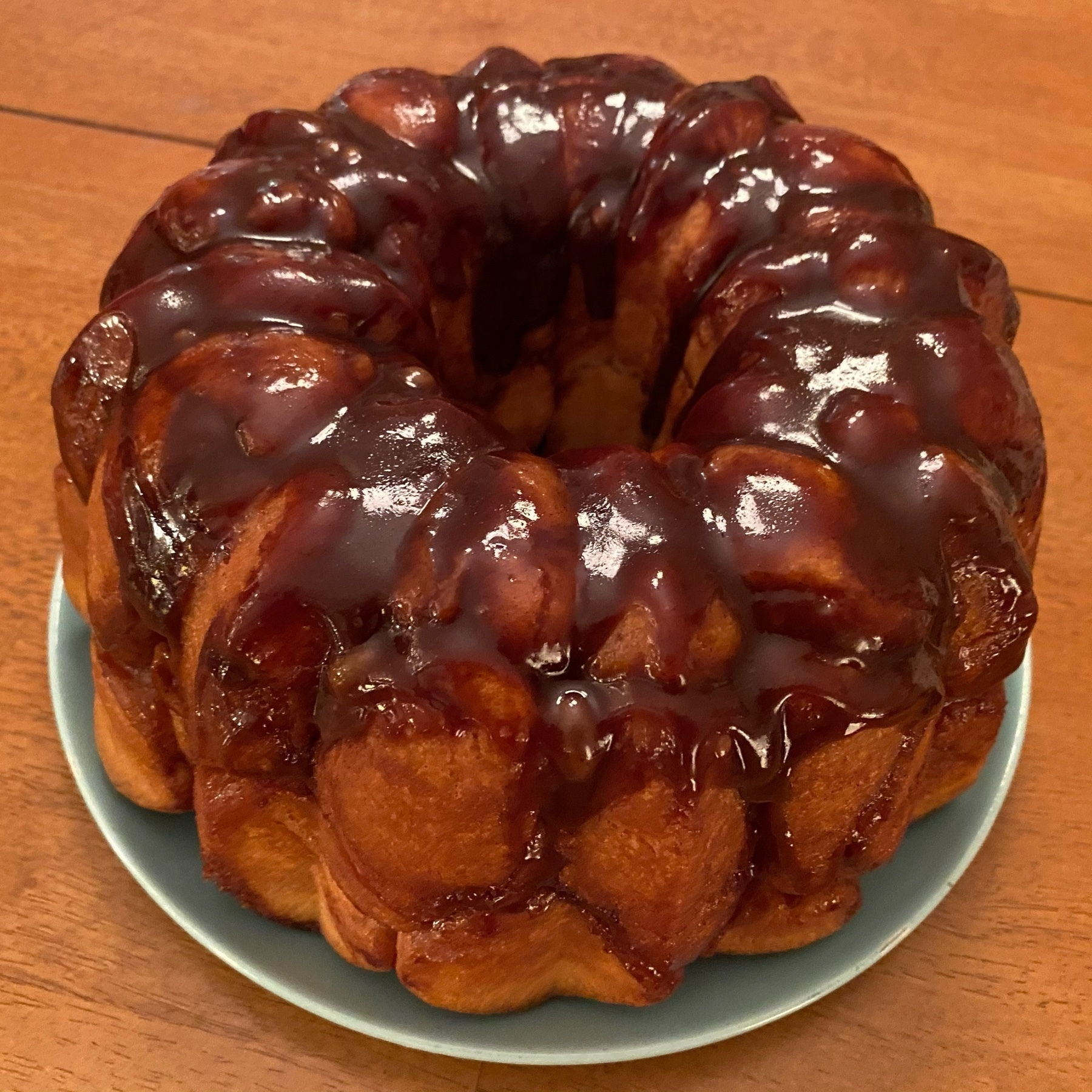 Picture of a Bundt cake with brown cinnamon icing.