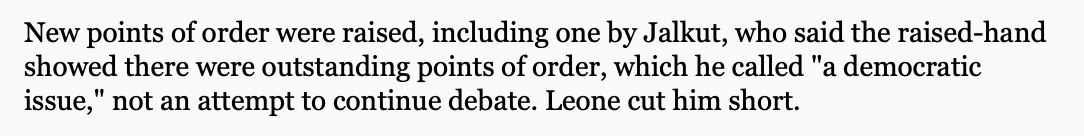 """Screenshot of an excerpt from Arlington Town meeting: """"New points of order were raised, including one by Jalkut, who said the raised-hand showed there were outstanding points of order, which he called """"a democratic issue,"""" not an attempt to continue debate. Leone cut him short."""""""