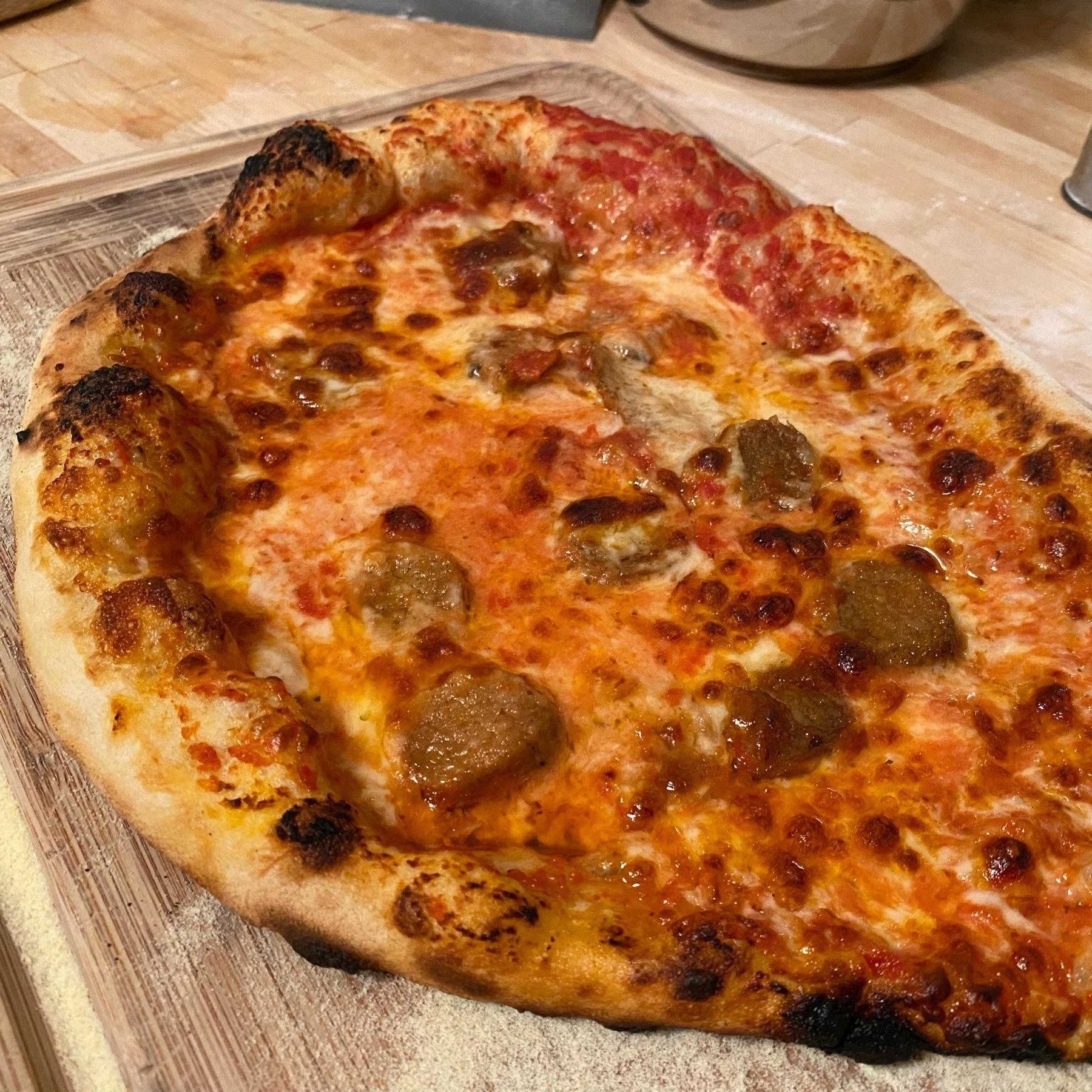 homemade pizza shaped like a teardrop