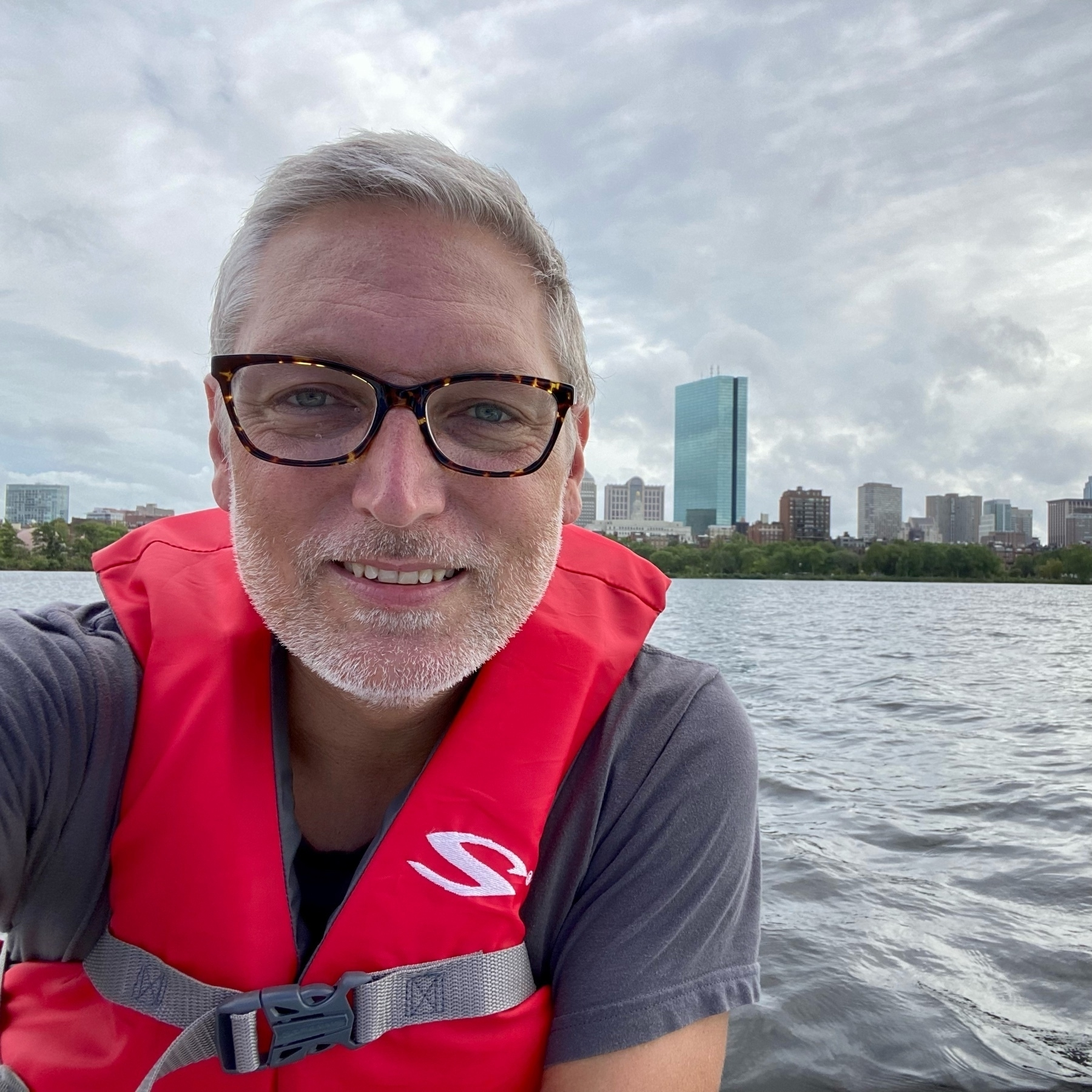 Selfie on a sailboat with Boston skyline behind me.